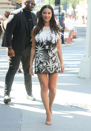 Olivia Munn looked summery in a foliage-motif mini dress with a fringed yoke while out in LA.