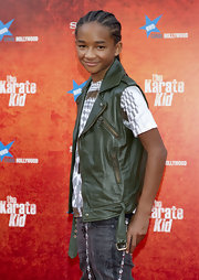 Jaden Smith paired his leather vest with a graphic t-shirt and distressed jeans.