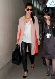 Kim Kardashian topped off her chic airport look with this two-tone swing coat.