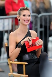 We were stumped on who could have designed this fab black cuff bracelet that Heidi Klum wore for a recent 'Project Runway' shoot. Turns out, she designed it herself!