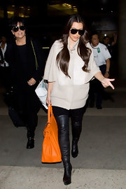 Kim showed off her large Kelly bag while arriving at LAX airport.