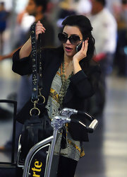 "Kim K is a huge fan of dark oversized shades. Here she's rockin' the ""Wonderlust"" frames from her fave eyewear designer."
