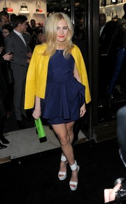 Pixie Lott went for a stylish color-block finish with a canary-yellow leather jacket by Karl Lagerfeld.
