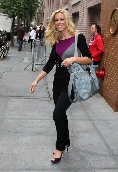 Kate Gosselin matched the pop of plum in her top with jewel-toned plum peep-toe pumps.