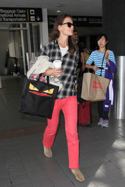 Katie Holmes added a striking pop of color of with a pair of hot-pink jeans.