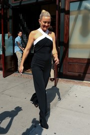Kate Hudson was spotted outside her hotel wearing a sexy-chic black-and-white halterneck jumpsuit by Roland Mouret.