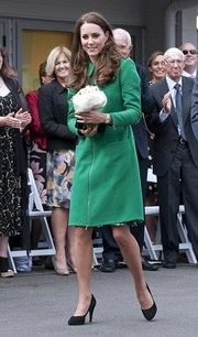 Kate Middleton visited the Rainbow Place Children's Hospice wearing a green zip-up wool coat by Erdem.