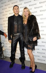 Kate Moss opted for a glamorous look for her night out in London, when she wore this classic fur coat.