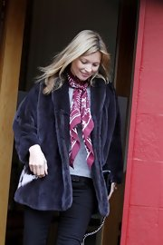 The model added a pop of color to her look with a burgundy scarf.