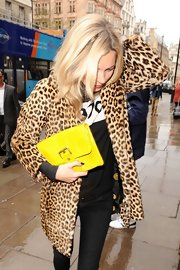 An electric yellow buckled clutch amped up the playfulness of Kate's leopard-print coat.