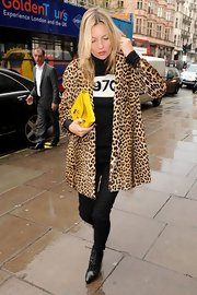 Kate Moss' all-black look became at once modern and chic when she layered on a swingy leopard-print coat.