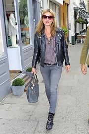 Kate Moss' black leather jacket gave her casual daytime look a rocker, edgy feel.