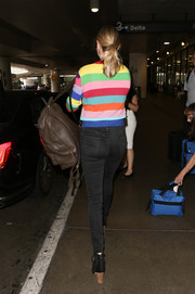 Kate Upton arrived on a flight at LAX carrying a classic brown leather backpack.