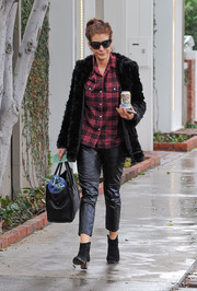 Kate Walsh teamed her pants with a red and black plaid button-down.