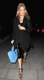 Kate Hudson was spotted out in London wearing a black trenchcoat over a silk dress.