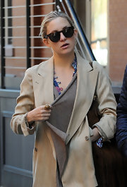Kate threw her hair up in a bun and sported a dark pair of wayfarer shades while out in NYC.