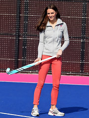 Kate Middleton showed off her athleticism in a sporty gray hoodie and feminine pink jeans.