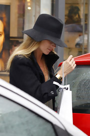 Kate stays dry in London for her shopping excursion in a wide brimmed walker hat.