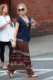 Kate looked boho-chic in a printed skirt with suede fringe sandals.
