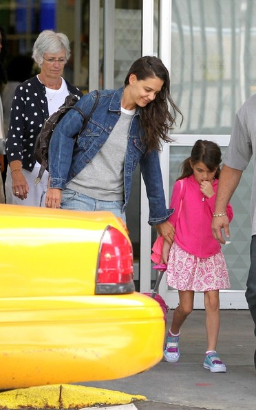 Katie Homes and Her Daughter Arrive in NYC