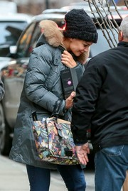 Katie Holmes geared up for freezing weather with a black knit beanie and a gray puffer jacket.