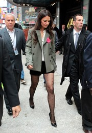 Katie Holmes visited 'Good Morning America' wearing a gray pea coat and a pair of black shorts.