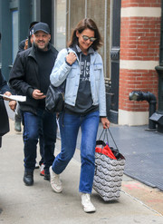 Katie Holmes kept it casual all the way down to her white Chuck Taylors.