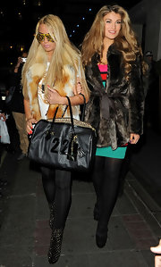 Katie Price rounded out her over-the-top street style with a black bowler emblazoned with the number 22.