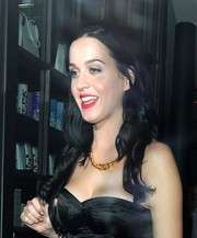 Katy Perry paired a gold chain necklace with a black outfit for a night out in London.