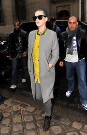 A tame Katy Perry was spotted in Paris in a sophisticated gray collarless coat and matching jeans.
