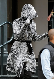 Katy Perry looks to have just played in the snow in this clever flocked wrap hooded jacket.