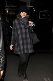 Keira Knightley looked warm and preppy in a sweet plaid charcoal coat.