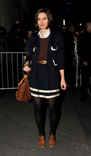 Keira Knightley paired her preppy attire with distressed cognac leather brogues.