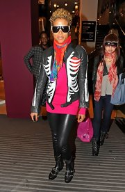 Kelis showed off her skeleton printed leather jacket while hitting Oxford street.