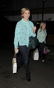 Holly Willougby opted for a light turquoise button down with a cool circular print for her look while out at the Riverside Studios.