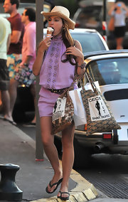 Kelly Brook indulged in some ice cream while on vacation. She totted around a few canvas tote bags.