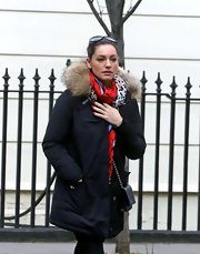 Kelly Brook added some color to her daytime look with a red and purple leopard print scarf.