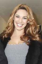 Kelly Brook was out and about in London wearing her shiny hair in long soft waves.