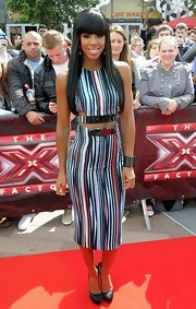 Kelly stepped onto the 'X-Factor' red carpet wearing a sleek runway ensemble complete with a high-waisted body con skirt and crop top.