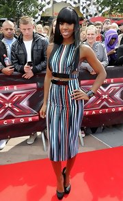 Kelly showed off her fierce figure in a dramatic fitted crop top for the 'X-Factor' Auditions.