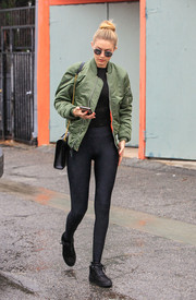 Gigi Hadid put her super-slim legs on display in black leggings by Under Armour while out on a stroll.