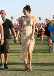 Kendall Jenner looked quite the boho babe in this cream-colored lace cutout dress during Coachella.