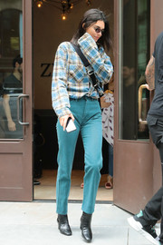 Kendall Jenner paired her shirt with bright blue jeans.