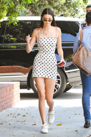 Kendall Jenner paraded her supermodel figure in a fitted polka-dot mini dress by Bec & Bridge while out in LA.