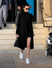 Kendall Jenner kept her feet comfy in white lambskin sneakers by Celine.