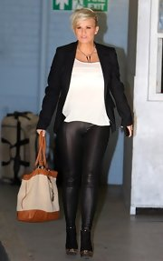 Kerry Katona looked rocker chic in leather leggings as she took an afternoon stroll.