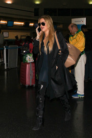 Khloe Kardashian sealed off her leather look with a pair of black over-the-knee boots.