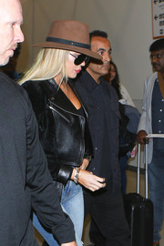Khloe Kardashian kept a low profile in a brown walker hat and a pair of dark glasses while making her way through LAX.