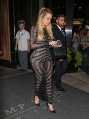 Khloe Kardashian put on a seductive show in a curve-hugging, see-through black mesh dress as she left the Trump Hotel.