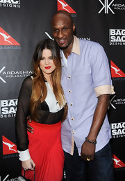 Lamar Odom went for a boyish feel with this pastel-blue button-down shirt during the Kardashian Kollection Handbag launch.